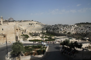 Mount of Olives in the background and the south end of the Temple Mount on the left side.  The city of David goes down the south side of the Temple Mount below where the Temple stood.