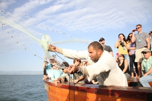 "Demonstration of the traditional ""fishing"" on the Sea of Galilee."