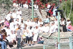 Pilgrims awaiting the baptism at the edge of the Jordan River
