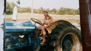 Eric takes Rhiannon for a ride on the big tractor.