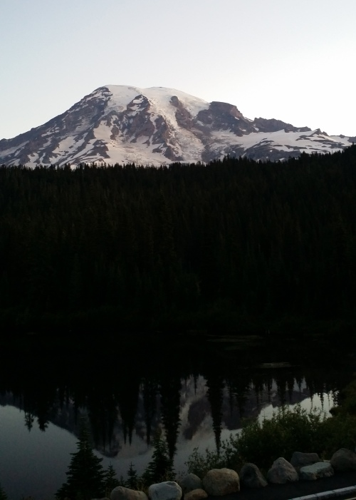 Sunrise on Mount Rainier viewed across Reflection Lake.