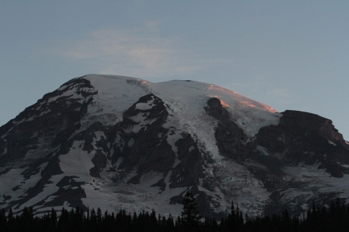 The first kiss of sun on Mount Rainier's peak.