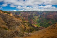 The Waimea Falls near the headwaters of the Waimea River is the cause of the canyon.