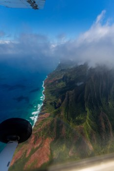 Desi turned from the Waimea Canyon and then headed into the clouds over the top of the island. We were in a white-out for about 30 seoncds and then, BOOM the Na Pali coast burst into view.