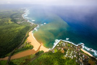 Waimea Beach on Oahu's North Shore. A big wave surfing tournament is held here when the conditions, at least 30 foot swells, allows.